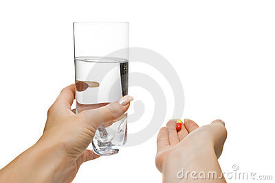 Helping hands with water and pills, isolated