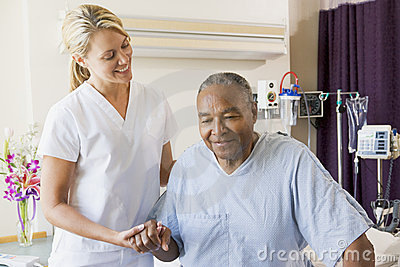 Helping man nurse senior to walk