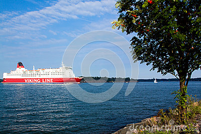 HELSINKI, FINLAND-AUGUST 18: Viking Line ferry sails from the port of Helsinki,  Finland August 18 2013.Paromy Viking Line of regu Editorial Photo