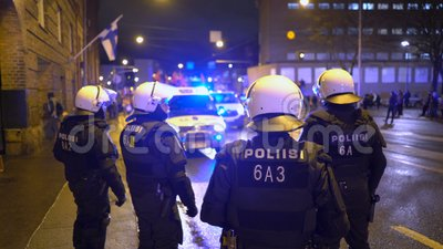 Police keep order during Antifa`s march and rally of far-right nationalists on Finland`s Independence Day. Helsinki, Finland - Dec 06, 2019: Police keep order stock video