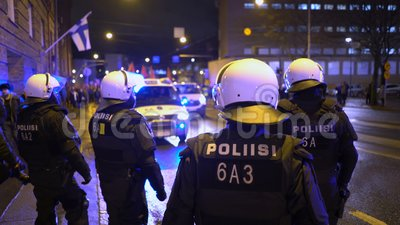 Police keep order during Antifa`s march and rally of far-right nationalists on Finland`s Independence Day. Helsinki, Finland - Dec 06, 2019: Police keep order stock footage