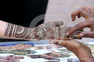 Henna designing on female hand
