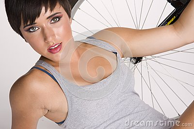 Woman Rests in Front of Her Bike Refreshed