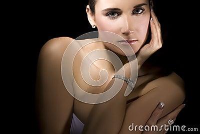 Her silver wristwatch