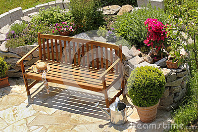 Herb garden and bench with little apple tree