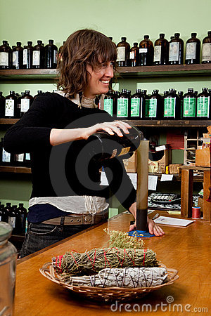 Herb store proprietor smiling