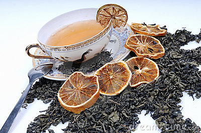 Herbal cup of tea with leaves and lemons