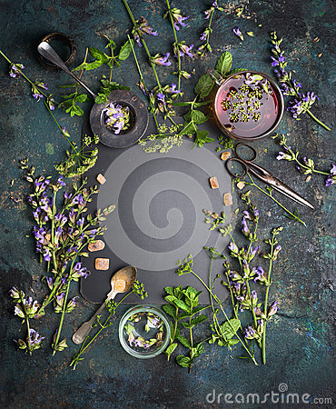 Free Herbal Tea Background. Various Fresh Herbs, Tea Tools And Cup Of Tea On Dark Vintage Background, Frame, Top View Royalty Free Stock Images - 72826269