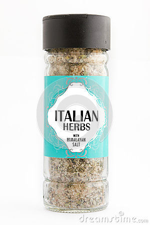 Herbs and spices in glass bottle