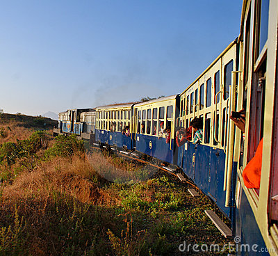 Heritage toy train taking a turn on hilly tracks Editorial Photography