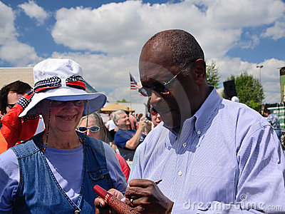 Herman Cain Signs Autograph Editorial Stock Photo