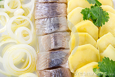 Herring fish fillets with potato and onion