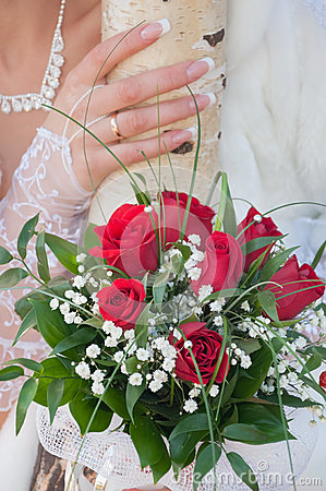 Het boeket van het huwelijk van rode rozen