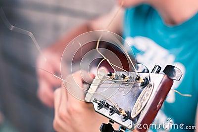 Het detail van de gitaar