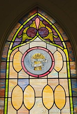 Het godsdienstige venster van het vlekglas