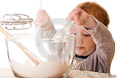Het koken van de jongen