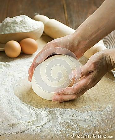 Het koken van het brood. Deeg