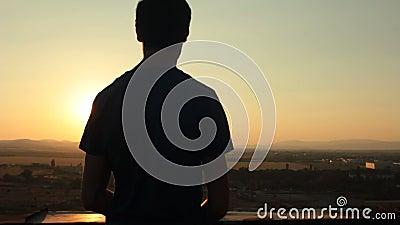Het letten op van de mens zonsondergang