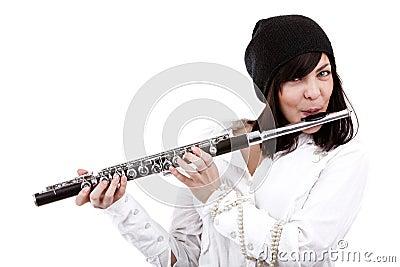 Het spelen van het meisje op fluit