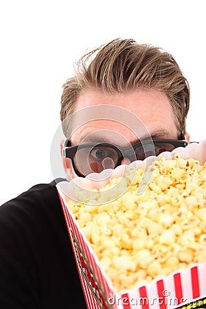 Hiding behind the popcorn bucket