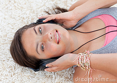 High angle of teen girl listening to music
