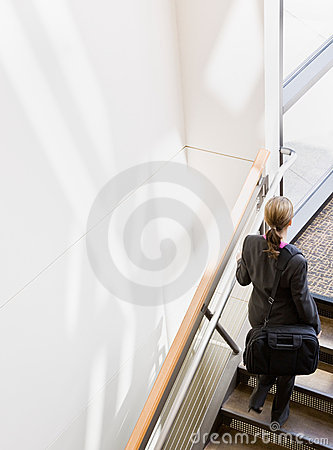High angle view of businesswoman ascending stairs