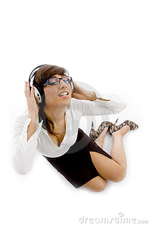 High angle view of female attorney tuned to music