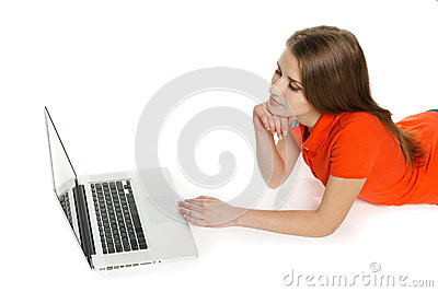 Woman lying on the floor with her laptop
