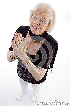 High angle view of praying old woman