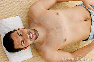 High angle view of smiling male at spa