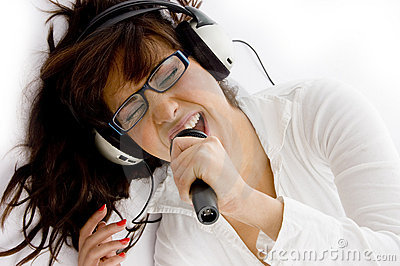 High angle view of woman enjoying music