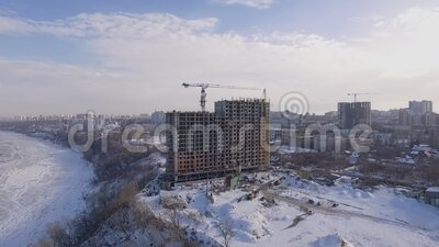 High building under construction in city at winter time, aerial shot, architecture. Of modern cities stock video footage
