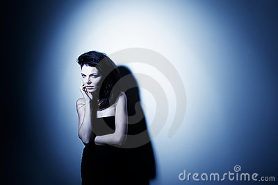 High contrast fashion portrait of attractive woman