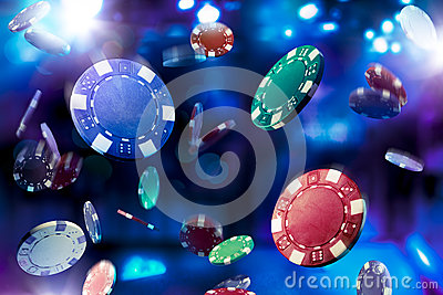 High contrast image of casino chips falling