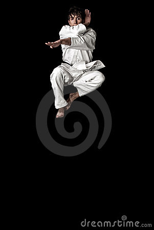 High Contrast karate young male fighter jump