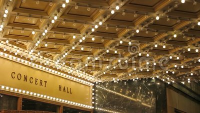 High definition of blinking concert hall ceiling lights on broadway along a entertainment street 1080p. High definition movie of blinking concert hall theater stock footage