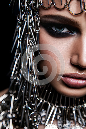 Free High Fashion Beauty Model With Metallic Headwear And Dark Makeup And Blue Eyes On Black Background Royalty Free Stock Photography - 84796407