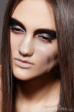 High fashion female model. Evening glitter make-up