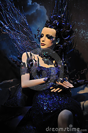 High fashion model in blue dress and fantasy s