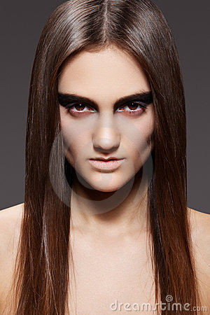 High fashion model. Evening make-up, straight hair