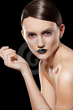 High fashion model. Hairstyle, make-up, black lips