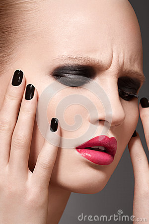 High fashion model with make-up and nails manicure