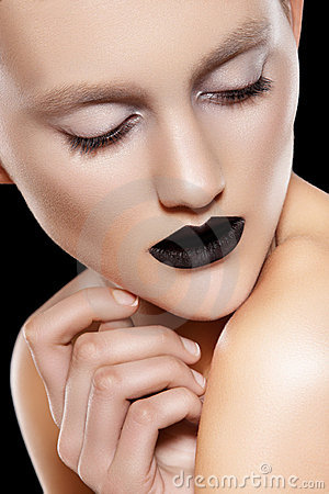 High fashion model. Make-up trend, rock black lips
