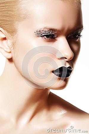 High fashion model. Silver make-up, black lips