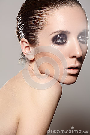 High fashion style. Model with dark gloss make-up, wet hairstyle
