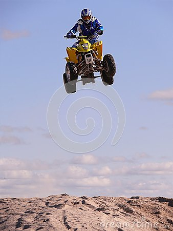 High jump on quadrocycle. Editorial Stock Image