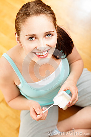 Free High Key Portrait  Young Caucasian Woman Eating Yogurt At Home Stock Photo - 31657820