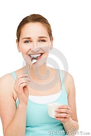 Free High Key Portrait Young Caucasian Woman Eating Yogurt Isolated Stock Image - 31659101