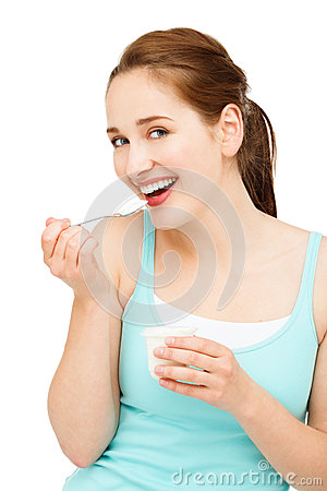 High key Portrait young caucasian woman eating yogurt isolated