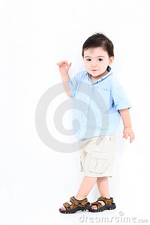 High Key Toddler Boy Standing Against White Wall